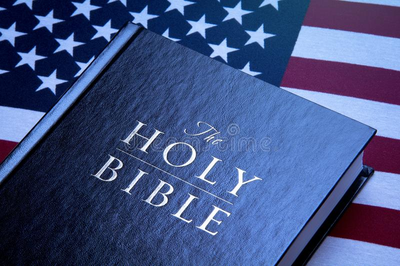 Holy Bible & United States Flag stock photos