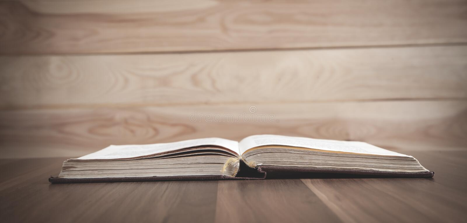 Holy Bible on the wooden table royalty free stock image