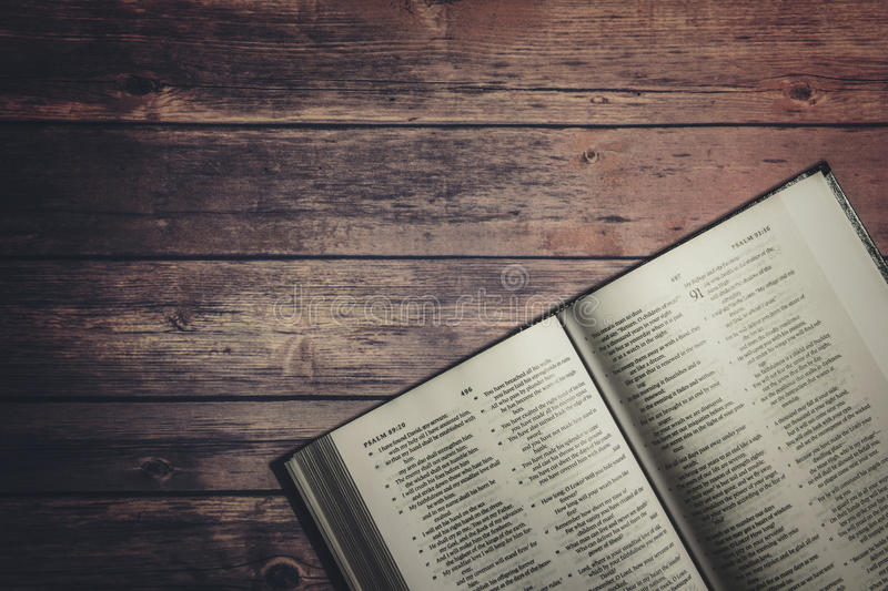 The Holy Bible on wooden table royalty free stock image