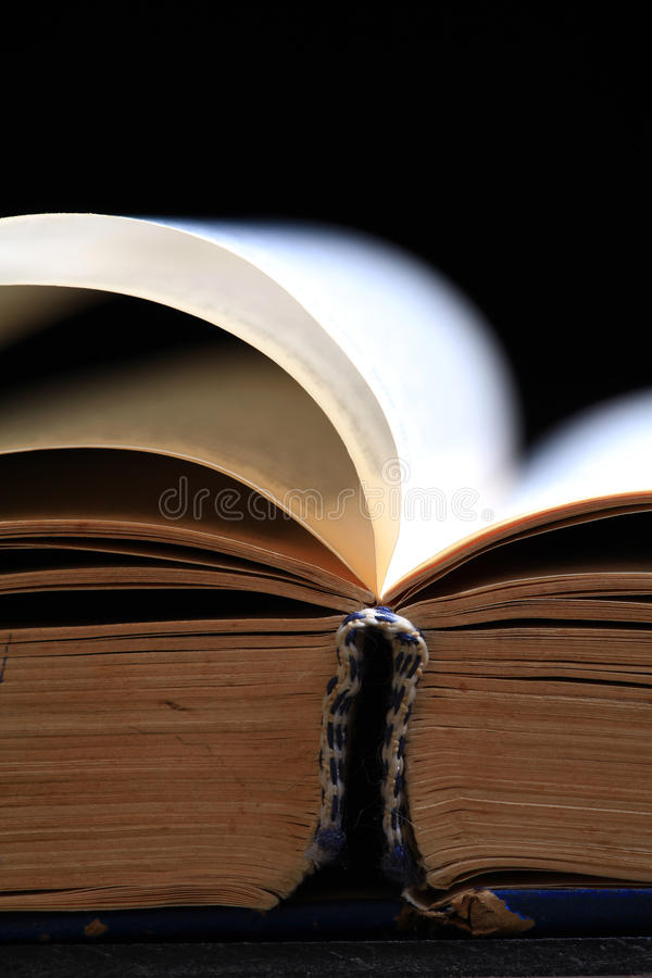 Holy book pages. Folded pages of holy book with black background royalty free stock image