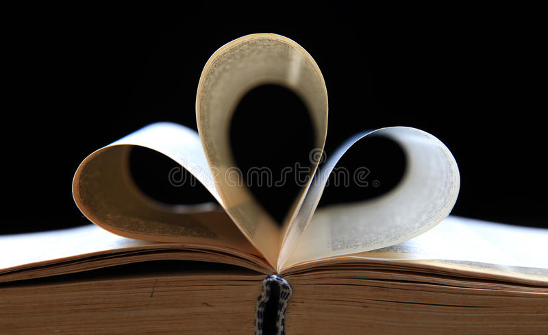 Holy book pages. Folded pages of holy book with black background stock image