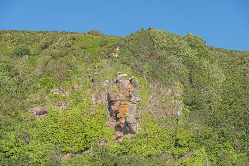 The Holy Caves or  Hawking Craig Cave Situated Above Ground Leval in Portencross on the Summer Solstice in Scotland royalty free stock image