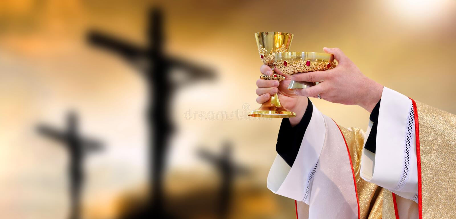 Holy communion on the background of three crosses on top of Golgotha. Easter holiday concept with empty space for text royalty free stock photo