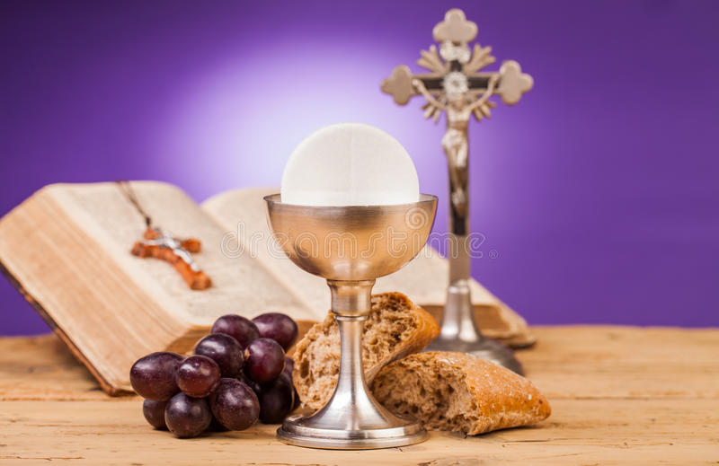 Holy communion composition. Holy communion chalice on wooden table royalty free stock photography