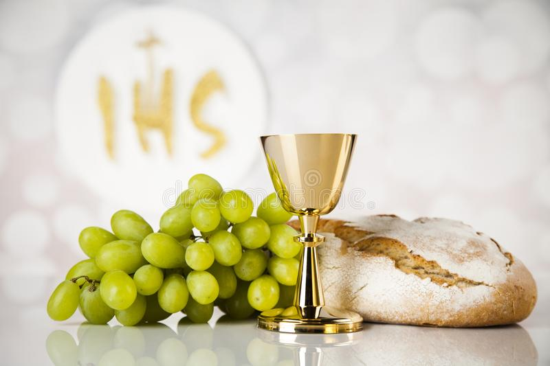 Holy communion a golden chalice, composition on white. Holy communion elements on white background stock photo