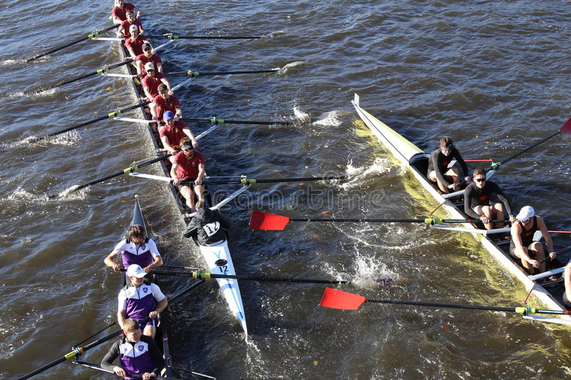 Holy Cross (left) Boston College (middle) Wesleyan (right) races in the Head of Charles Regatta. BOSTON - OCTOBER 22, 2016: Holy Cross (left) Boston College ( stock photo
