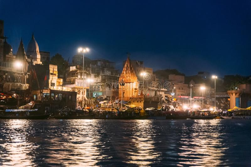 Holy Dasaswamedh Ghat with light reflected on the river that view from the boat at Varanasi Ganga Aarti. Holy Dasaswamedh Ghat with light reflected on the river royalty free stock photo