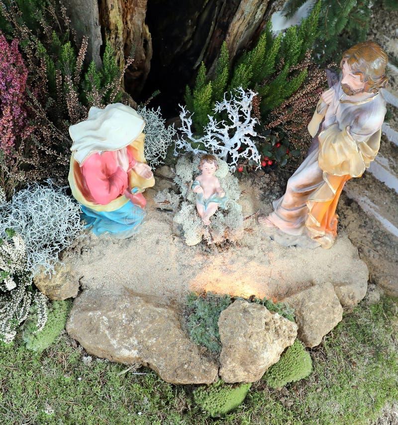 Holy Family on the the crib with Saint Mary Joseph and baby Jesu stock image