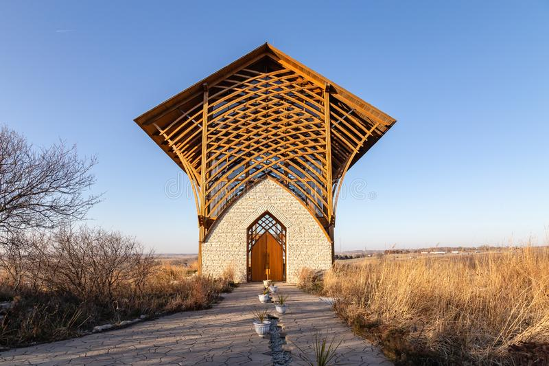 Holy Family Shrine Gretna Nebraska with fall dry grass. The brown colors of the surrounding contrasts shaply with the luscious green of the summer months stock photography
