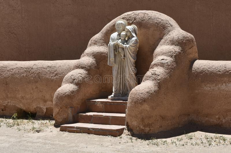 The holy family. Straw adobe niche with a traditional style statue of the Holy Family, Los Ranchos de Taos, New Mexico stock images