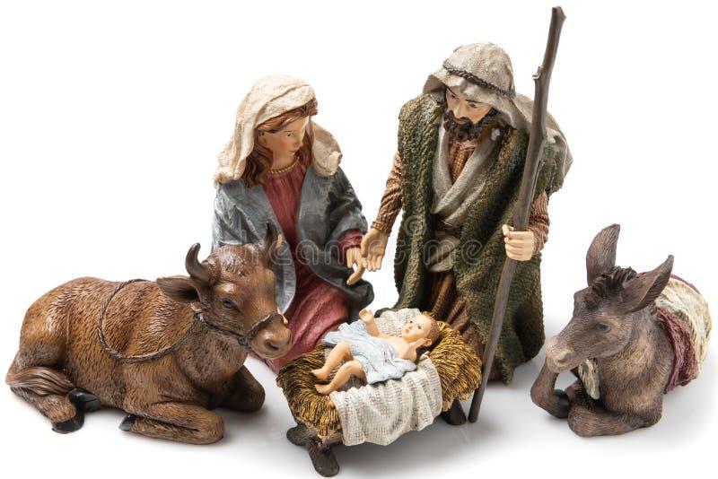 Holy Family: Virgin Mary, Saint Joseph, the Ox, the donkey and Baby Jesus Ceramic Figurines stock photos