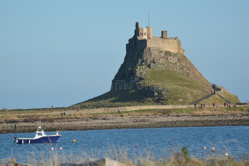 `Holy Island`, Lindisfarne Northumberland. Historic site. The Holy Island of Lindisfarne, also known simply as Holy Island,[3] is a tidal island off the royalty free stock photos