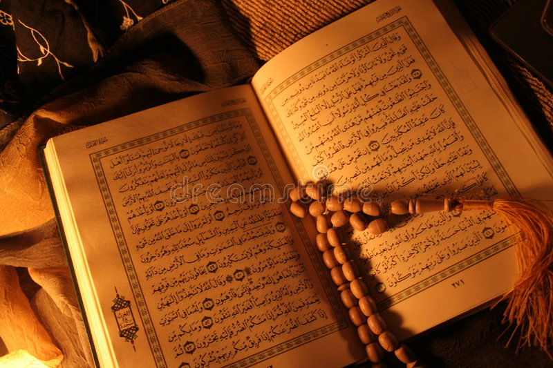 Holy Koran book and rosary royalty free stock photo