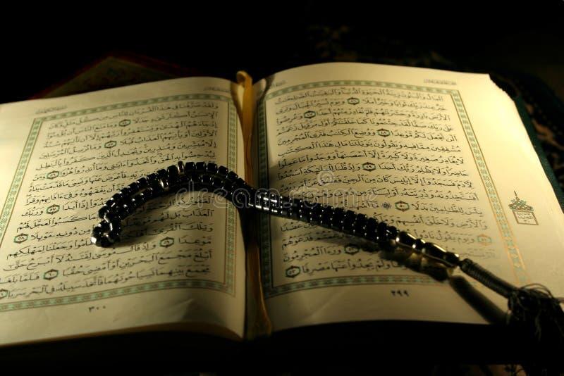 Holy Koran book and rosary stock photo