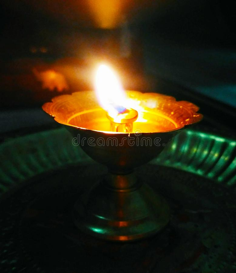 A holy lamp lit during workship stock image