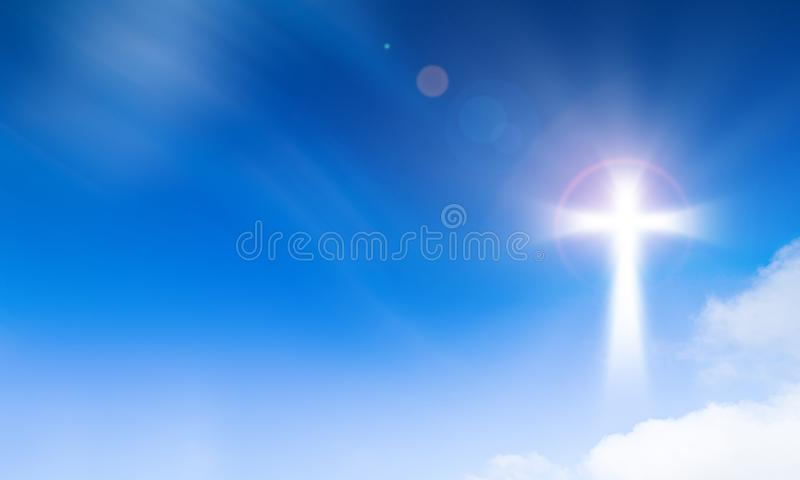 Holy light of crucifix cross on blue sky background. Hope and freedom concept. Cross royalty free stock image