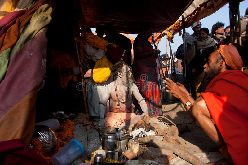 Holy man Naga Baba sit inside the tent stock photo