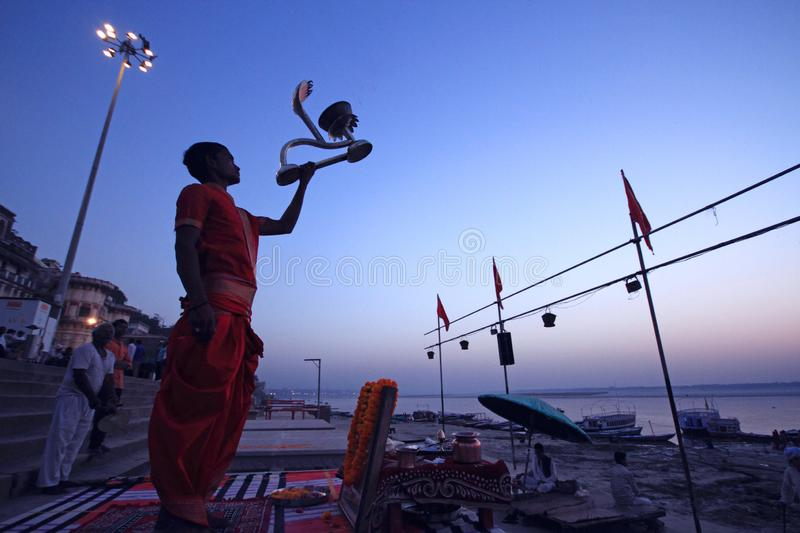 A holy man is praying by the ghats of river ganges in Varanasi stock photo