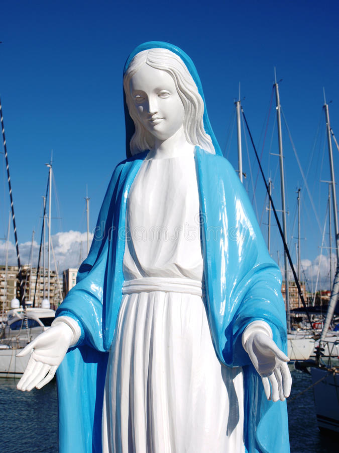 Holy Mary. Statue in Nettuno harbour, Italy royalty free stock photos
