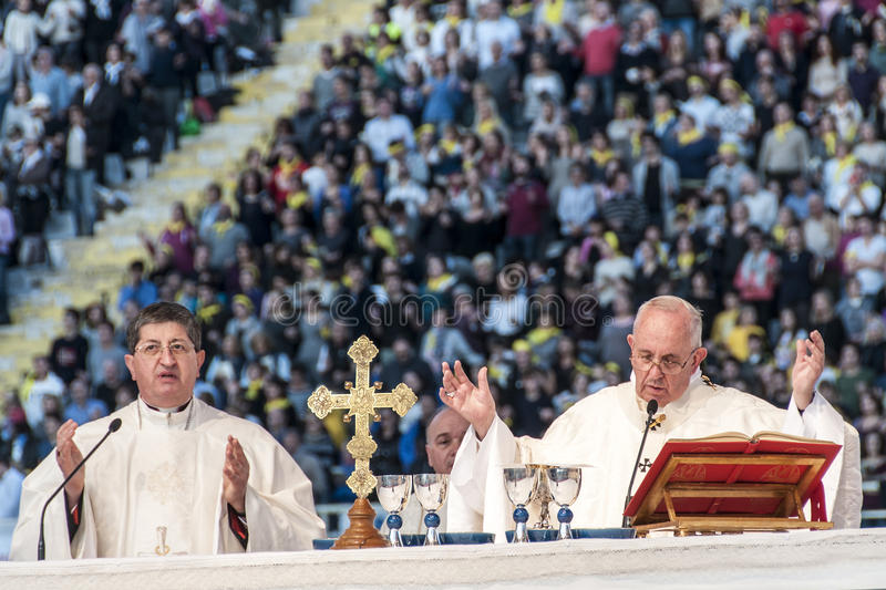 Holy mass with Pope Francis. Pope Francis celebrates the holy mass in the stadium of Florence, at the conference of the Italian Church stock images