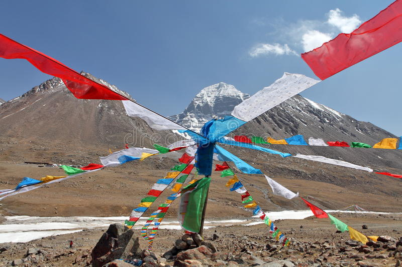 Holy Mount Kailash in Tibet. And Buddhist prayer flags on foreground royalty free stock images