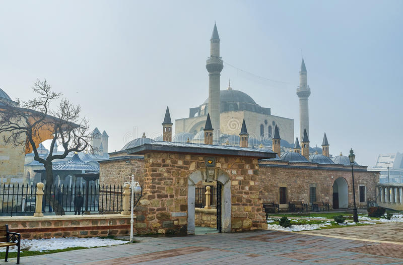 The holy places of Konya. The view on the roofs of the dervish cells with the high minarets of Selimiye Mosque on the background, Konya, Turkey royalty free stock image
