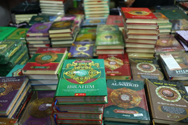The Holy Qur`an and various Islamic-themed books. Are sold in a bookstore, Batang Indonesia July 30, 2019 royalty free stock image