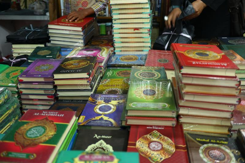 The Holy Qur`an and various Islamic-themed books. Are sold in a bookstore, Batang Indonesia July 30, 2019 royalty free stock photo