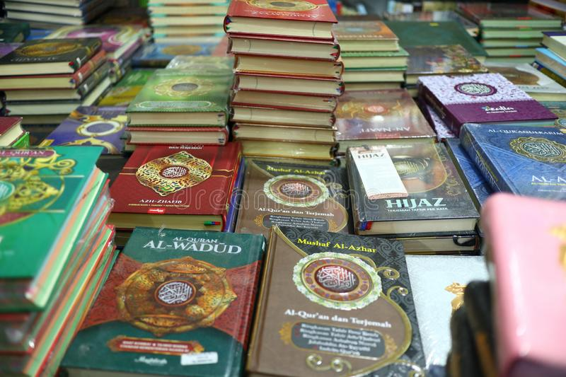 The Holy Qur`an and various Islamic-themed books. Are sold in a bookstore, Batang Indonesia July 30, 2019 stock photos