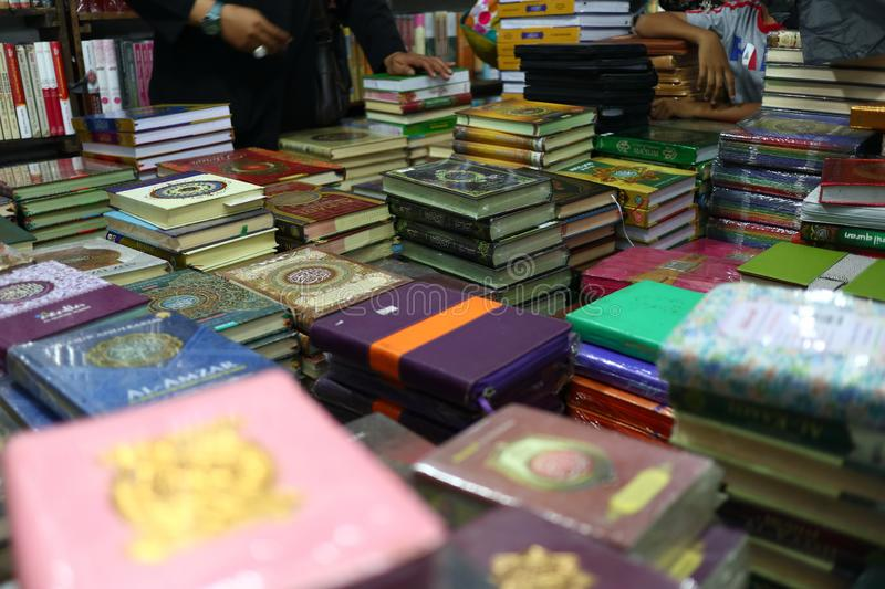 The Holy Qur`an and various Islamic-themed books. Are sold in a bookstore, Batang Indonesia July 30, 2019 royalty free stock photos