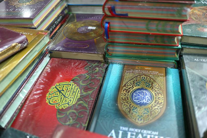 The Holy Qur`an and various Islamic-themed books. Are sold in a bookstore, Batang Indonesia July 30, 2019 royalty free stock images