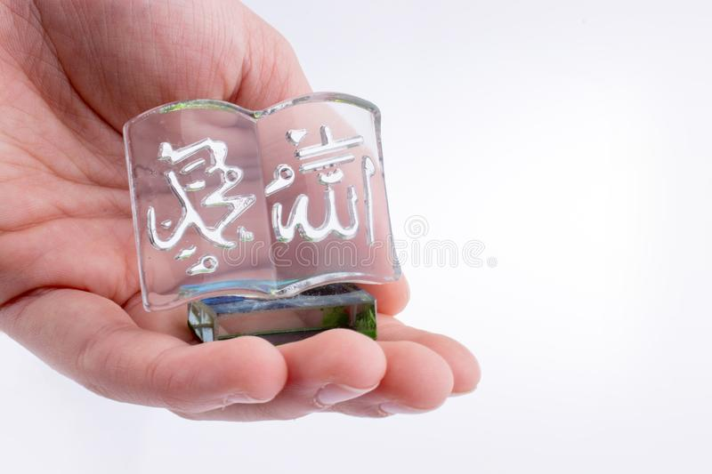 The Holy Quran. Hand holding Miniature Holy Quran on a white background stock photos