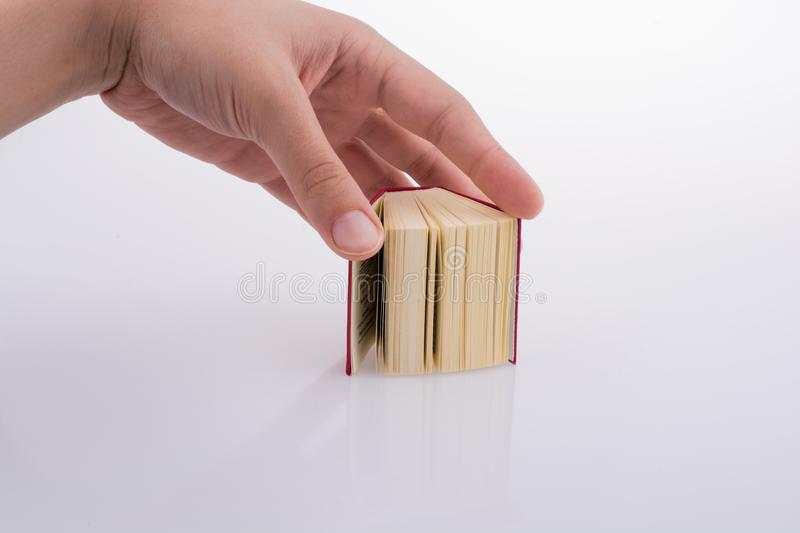 The Holy Quran. Hand holding The Holy Quran on a white background stock photo