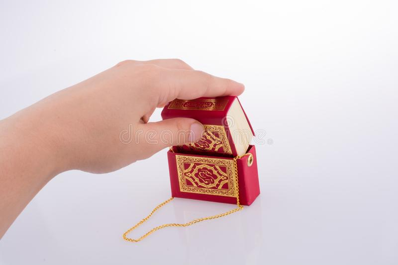 The Holy Quran. Hand holding The Holy Quran on a white background stock images