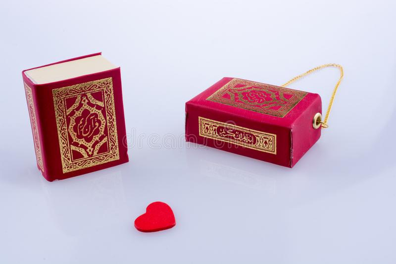 The Holy Quran. With a heart on a white background stock image