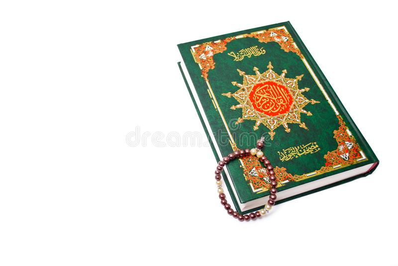 The Holy Quran. Isolated over white background. Muslim holy book and guidance royalty free stock photos