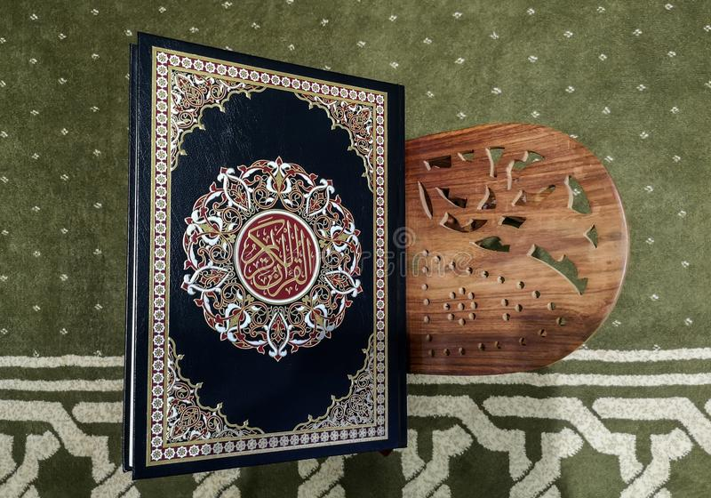 Holy Quran placed inside a mosque on a wooden stand royalty free stock photo