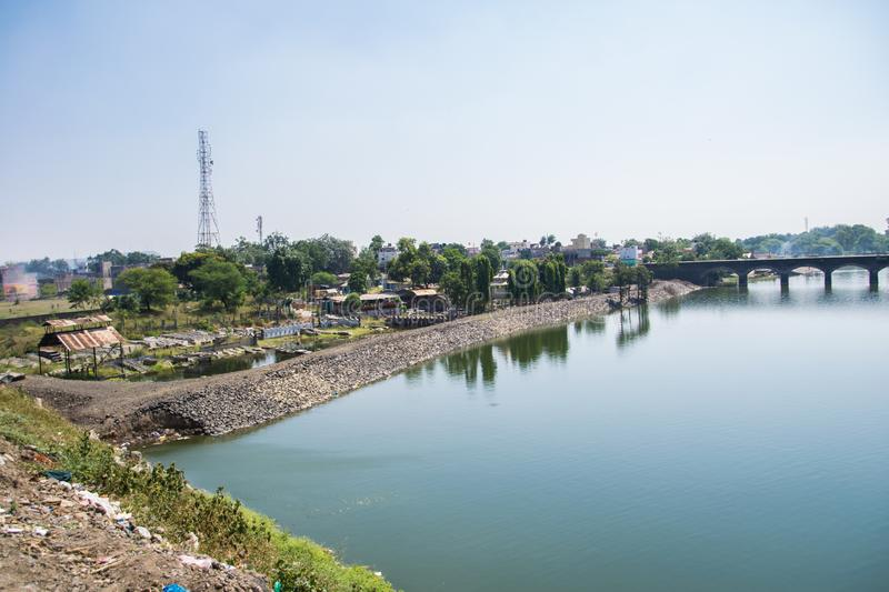 Holy River Kshipra near Dewas India. Holy River Kshipra flowing near Dewas Madhya Pradesh India with its bank and surroundings royalty free stock image