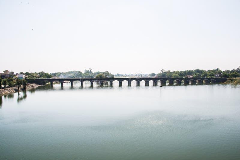 Holy River Kshipra near Dewas India. Holy River Kshipra and its old bridge near Dewas Madhya Pradesh India stock photo