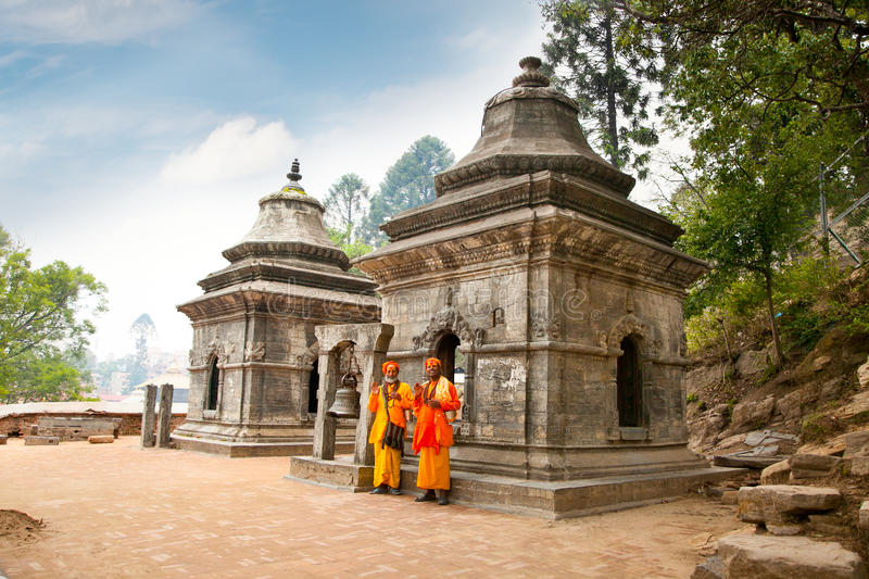 Holy Sadhu blessing in Pashupatinath Temple. Kathmandu, Nepal. Holy Sadhu men with traditional painted face, blessing infront of Eighteen Shivalaya in stock photo