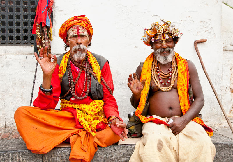 Holy Sadhu men with traditional painted face, blessing in Pashupatinath Temple. May 18, 2013 in Kathmandu, Nepal. royalty free stock photo