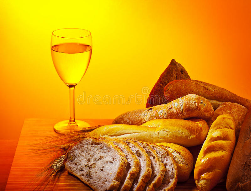 Holy supper. Communion dinner, bread and glass of wine, Sunday christian traditional food, celebrating religious holidays royalty free stock photography