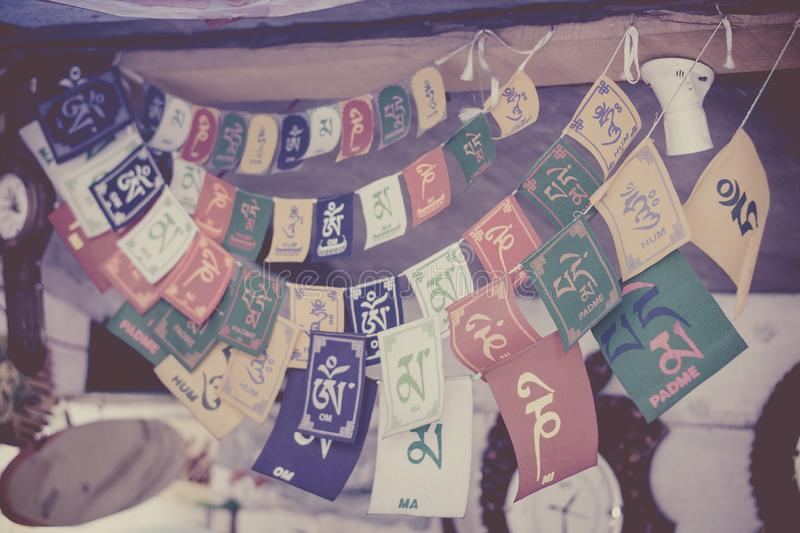 Holy tibetan prayer flags with shlokas. Traditionally, prayer flags are used to promote peace, compassion, strength, and wisdom. The flags do not carry prayers stock photography