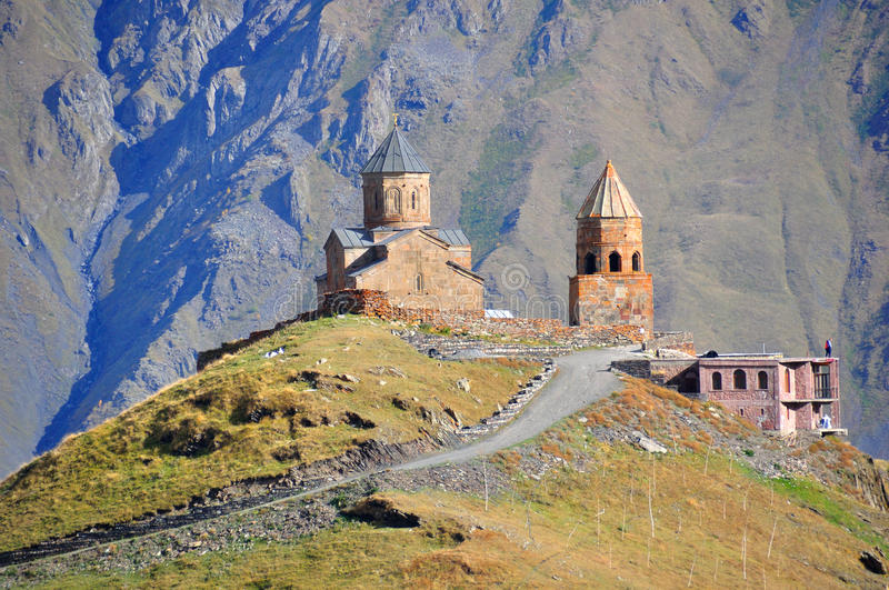 Holy Trinity Church, Kazbegi, Georgia stock images
