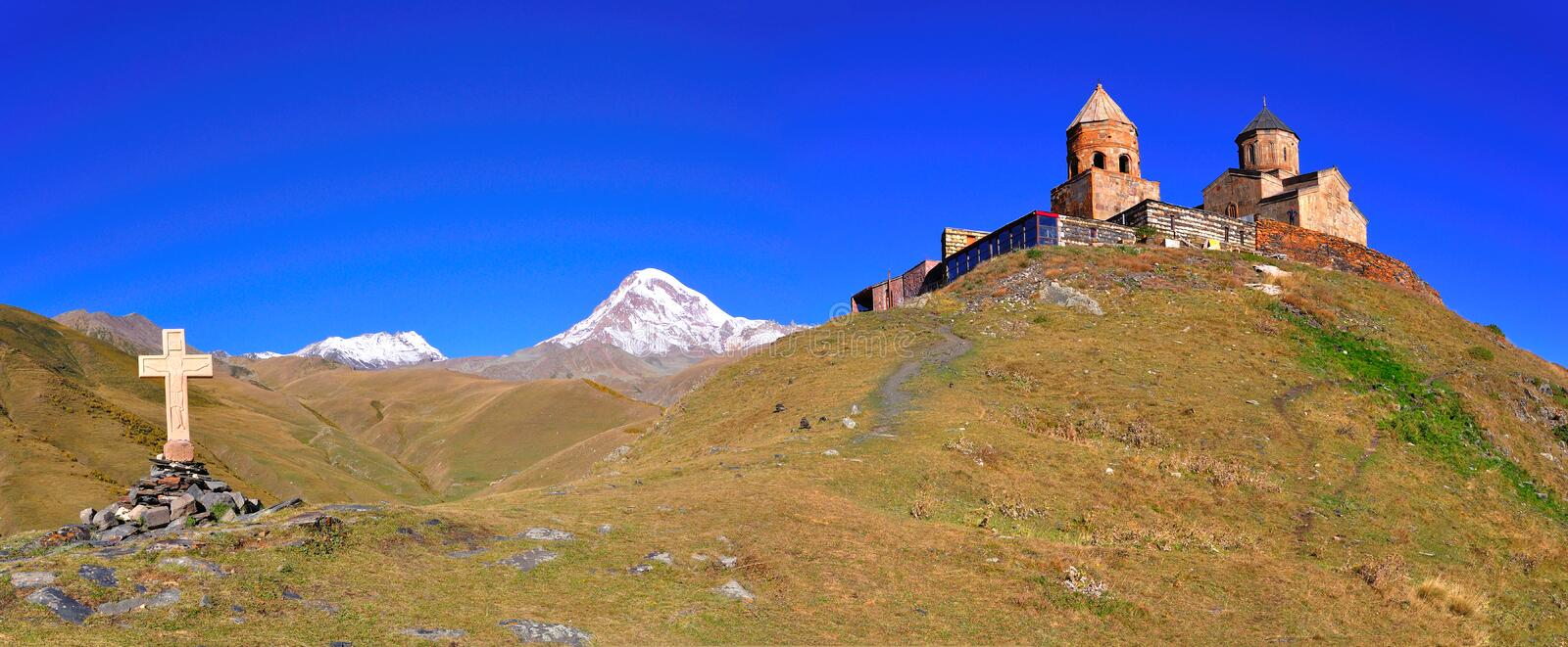 Holy Trinity Church Panorama, Kazbegi, Georgia stock image