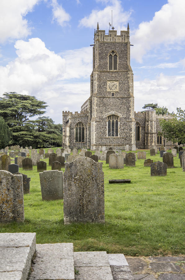Holy Trinity, Loddon, Norfolk. Village church with flint walls set in grave yard royalty free stock images