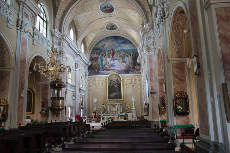Holy Trinity Roman Catholic Church - Baia Mare, Romania. The interior of the Holy Trinity Roman Catholic cathedral in Baia Mare, Maramures county, Romania. It stock photography