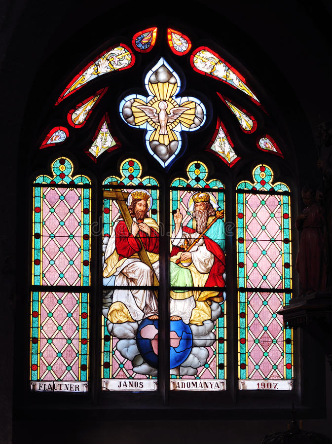 Holy Trinity stained glass windows in church royalty free stock photography