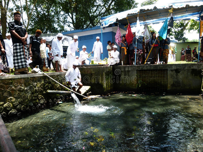 Holy water. Hindus perform the ceremony taking holy water at a spring village in Klaten, Central Java, Indonesia royalty free stock photos
