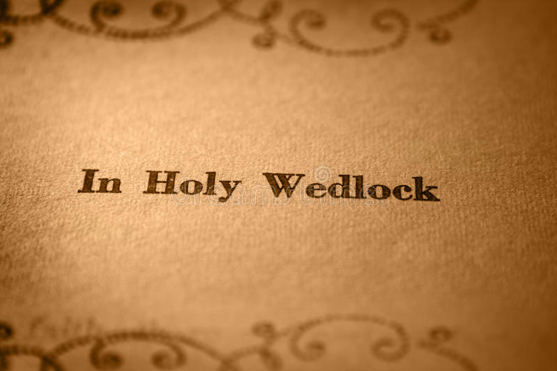 In holy wedlock. Concept of holy wedlock over yellow background stock photos